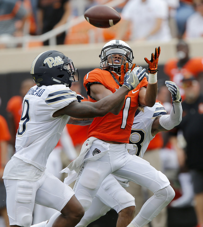 Photo - Pittsburgh's Jordan Whitehead (9) breaks up a pass for Oklahoma State's Jalen McCleskey (1) during a college football game between the Oklahoma State Cowboys (OSU) and the Pitt Panthers at Boone Pickens Stadium in Stillwater, Okla., Saturday, Sept. 17, 2016. Photo by Chris Landsberger, The Oklahoman