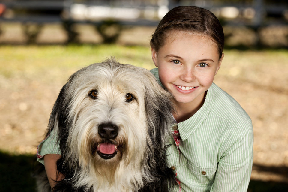 Photo -  Katie Hawkins stars as ten-year-old Caitlin, who begs her mom to adopt a dog (Bug Z) to keep her company, but soon faces losing him when someone claims the dog was his first. Photo:  Copyright 2012 Crown Media Holdings, Inc./Photographer Alexx Henry