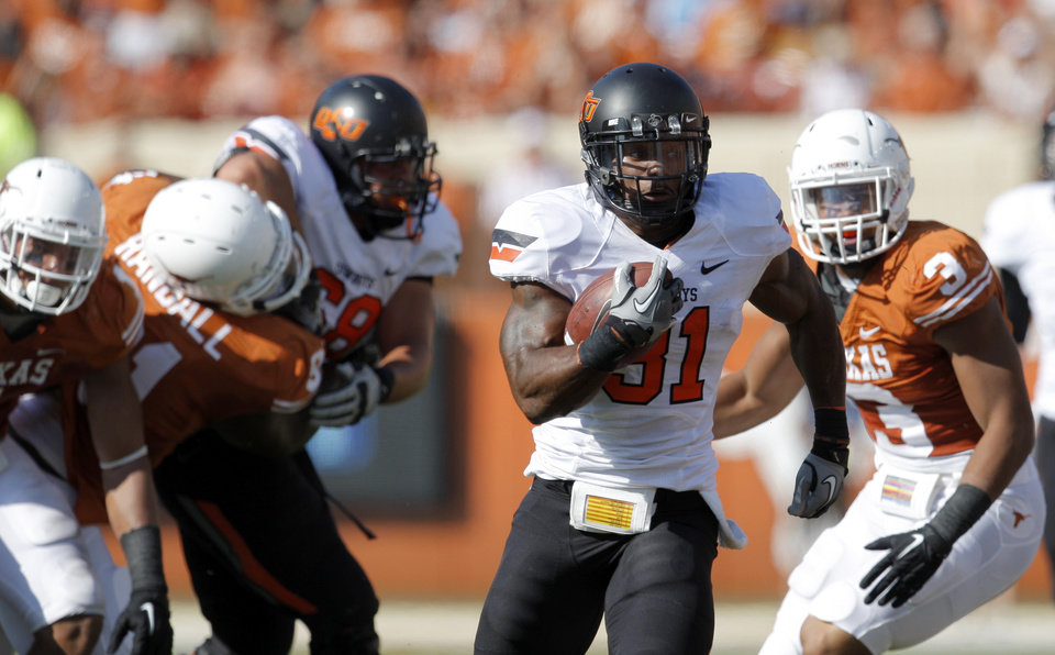 Photo - Oklahoma State's Jeremy Smith (31) gets by the Texas defense during first half of a college football game between the Oklahoma State University Cowboys (OSU) and the University of Texas Longhorns (UT) at Darrell K Royal-Texas Memorial Stadium in Austin, Texas, Saturday, Oct. 15, 2011. Photo by Sarah Phipps, The Oklahoman