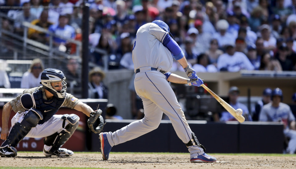Photo - Los Angeles Dodgers' Adrian Gonzalez connects for a solo home run against the San Diego Padres in the ninth inning of a baseball game in San Diego, Sunday, June 23, 2013.  he home run gave the Dodgers the lead and the 3-1 victory. (AP Photo/Lenny Ignelzi)