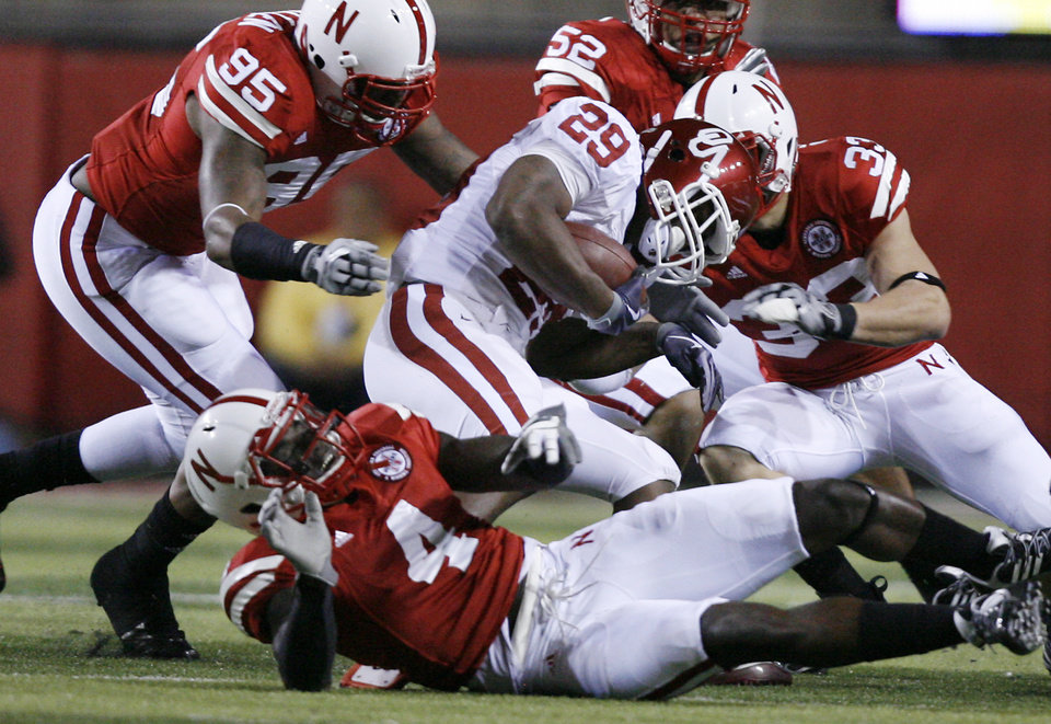 Oklahoma's Chris Brown (29) is stuffed by the Nebraska defense during the first half of the college football game between the University of Oklahoma Sooners (OU) and the University of Nebraska Cornhuskers (NU) on Saturday, Nov. 7, 2009, in Lincoln, Neb.