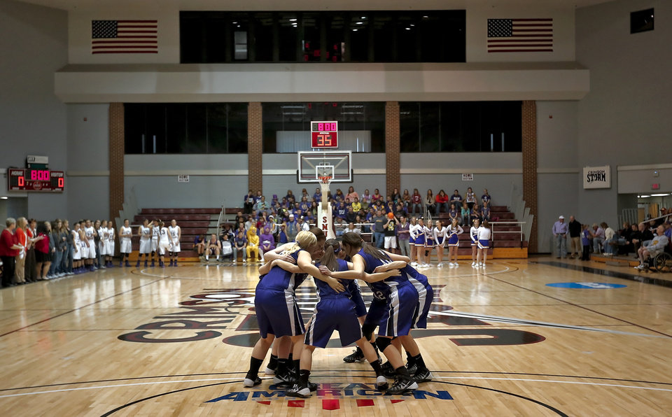 Photo - The Burlington girls huddle up before the start of the Class B girls state basketball quarterfinal game between Okarche and Burlington at Southern Nazarene University in Bethany, Okla. on Thursday, March 6, 2014.  Photo by Chris Landsberger, The Oklahoman