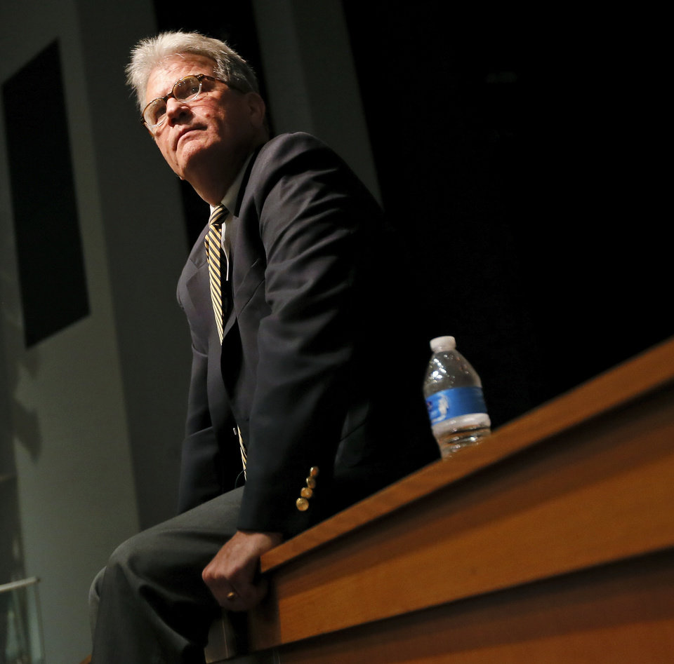 Photo - Sen. Tom Coburn listens to a question during a town hall meeting at Oklahoma City Community College's Visual and Performing Arts Center in Oklahoma City, Monday, Aug. 4, 2014. Photo by Nate Billings, The Oklahoman