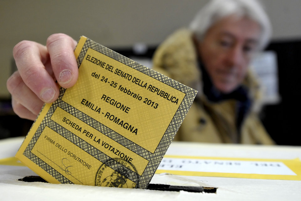 Photo - A man casts his vote for the Italian Senate, in Piacenza, Italy, Sunday, Feb. 24, 2013. Italy votes in a watershed parliamentary election Sunday and Monday that could shape the future of one of Europe's biggest economies. (AP Photo/Marco Vasini)