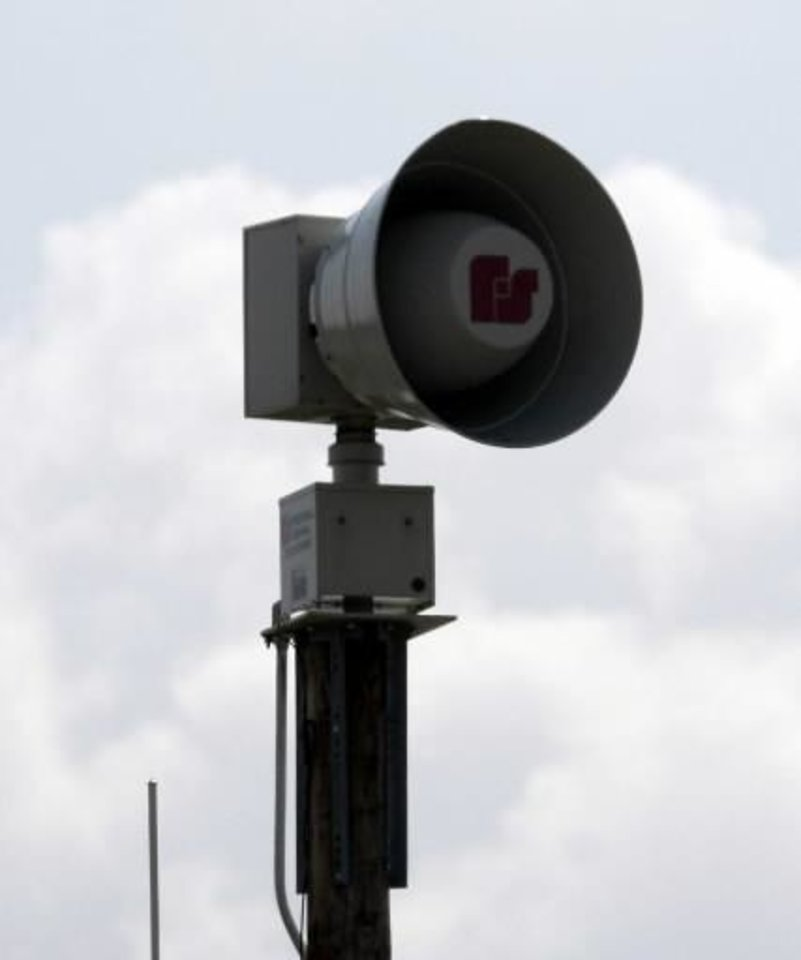A new  tornado  siren near Edmond Road and Santa Fe in Edmond on Thursday, Sept. 27, 2007. By John Clanton, The Oklahoman