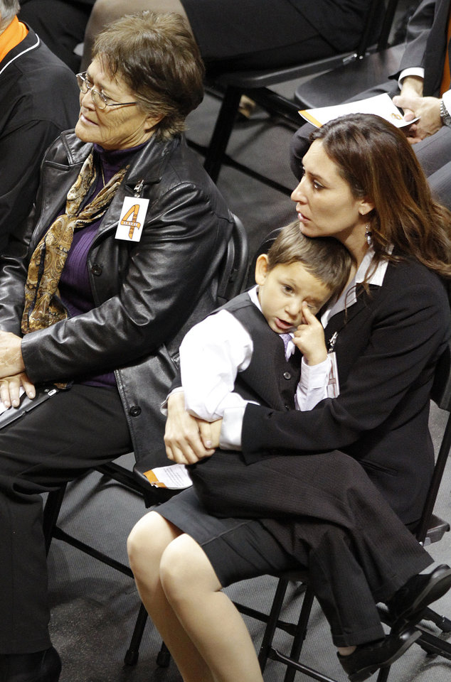 Photo - Miranda Serna's mother Nettie Herrera, left, and sister, Cassandra look on during the memorial service for Oklahoma State head basketball coach Kurt Budke and assistant coach Miranda Serna at Gallagher-Iba Arena on Monday, Nov. 21, 2011 in Stillwater, Okla. The two were killed in a plane crash along with former state senator Olin Branstetter and his wife Paula while on a recruiting trip in central Arkansas last Thursday. Photo by Chris Landsberger, The Oklahoman