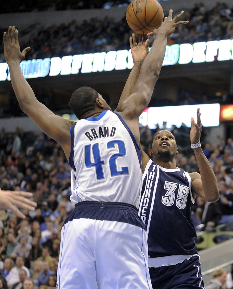 Oklahoma City Thunder forward Kevin Durant (35) shoots over Dallas Mavericks forward Elton Brand (42) in the second quarter of an NBA basketball game, Friday, Jan. 18, 2013, in Dallas. (AP Photo/Matt Strasen)