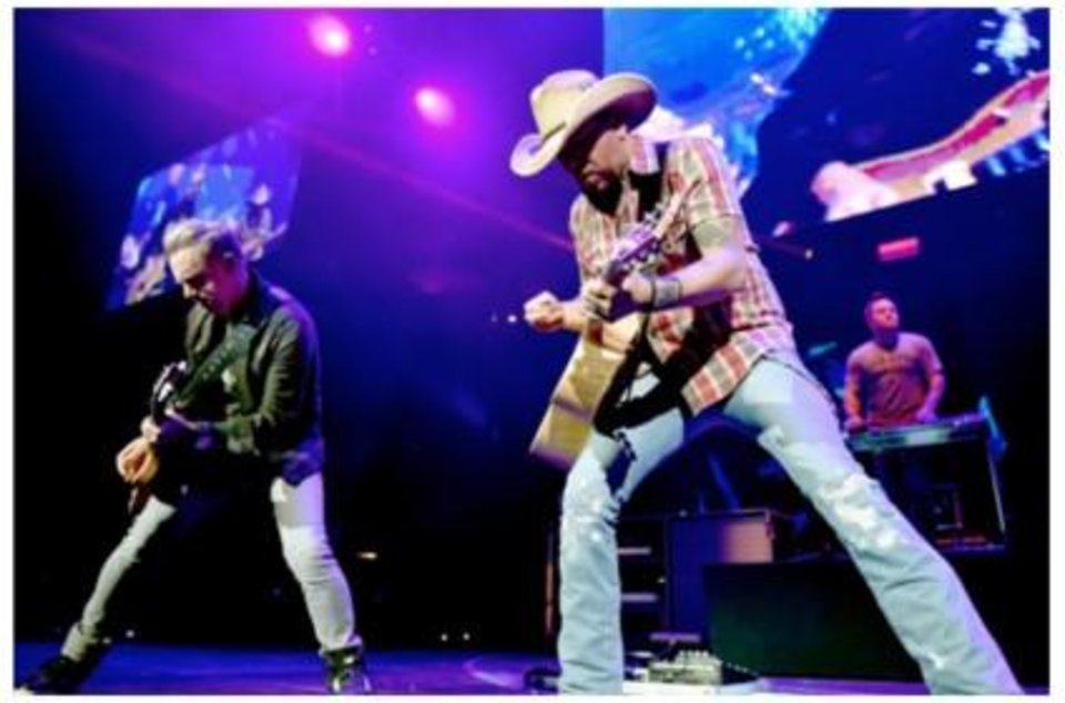 Photo - Jason Aldean performs at the Country Rising benefit concert Sunday at Nashville's Bridgestone Arena. Photos provided courtesy of Getty