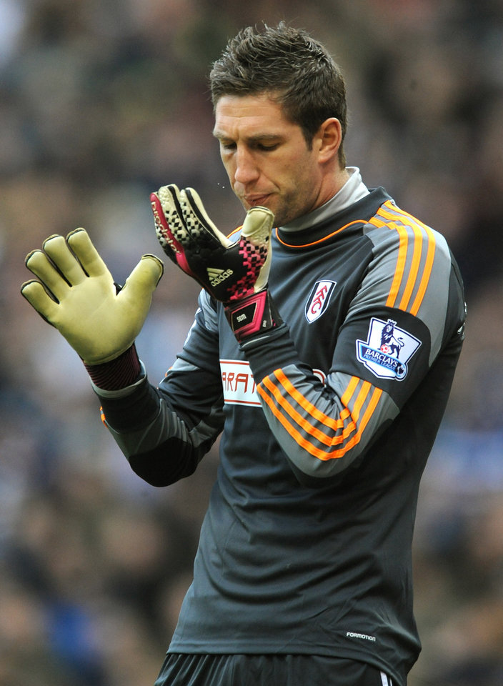 Photo - Fulham goalkeeper Maarten Stekelenburg during the English Premier League soccer match between West Bromwich Albion and Fulham at Hawthorns Stadium in West Bromwich, England, Saturday, Feb. 22 2014. (AP Photo/Rui Vieira)