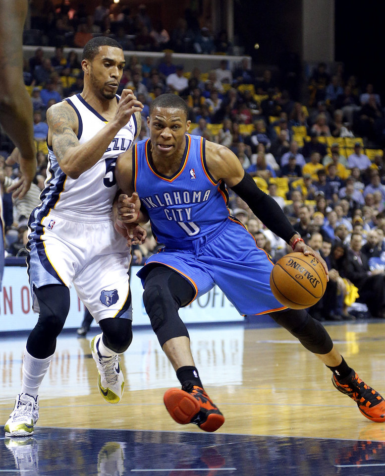 Oklahoma City's Russell Westbrook (0) drives to the basket as Memphis' Courtney Lee (5) defends during Game 6 in the first round of the NBA playoffs between the Oklahoma City Thunder and the Memphis Grizzlies at FedExForum in Memphis, Tenn., Thursday, May 1, 2014. Photo by Bryan Terry, The Oklahoman
