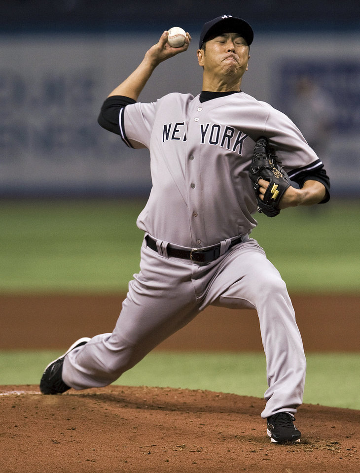 Photo - New York Yankees starter Hiroki Kuroda pitches against the Tampa Bay Rays during the first inning of a baseball game Friday, April 18, 2014, in St. Petersburg, Fla. (AP Photo/Steve Nesius)