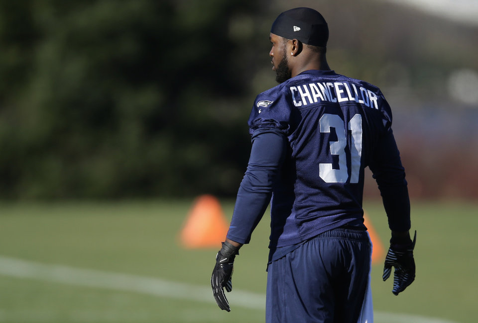 Photo - Seattle Seahawks strong safety Kam Chancellor walks on the field before NFL football practice, Friday, Jan. 24, 2014, in Renton, Wash. The Seahawks are scheduled to play the Denver Broncos in Super Bowl XLVII on Sunday, Feb. 2, in East Rutherford, N.J. (AP Photo/Ted S. Warren)
