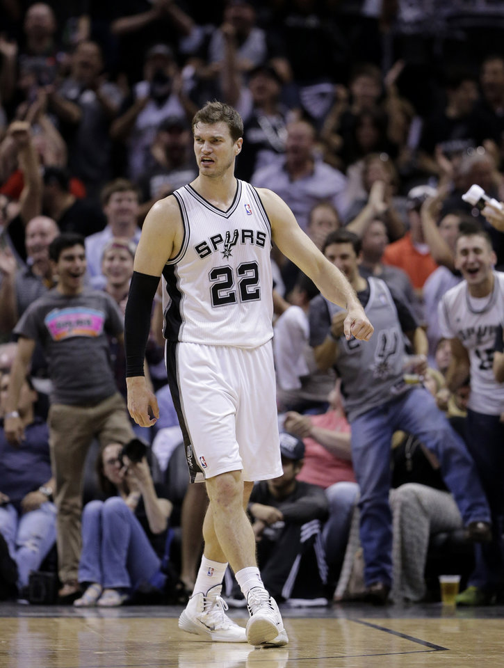 Photo - San Antonio Spurs' Tiago Splitter (22), of Brazil, walks upcourt after he scored against the Dallas Mavericks and was fouled on the play during the second half of Game 5 of the opening-round NBA basketball playoff series on Wednesday, April 30, 2014, in San Antonio. San Antonio won 109-103. (AP Photo/Eric Gay)