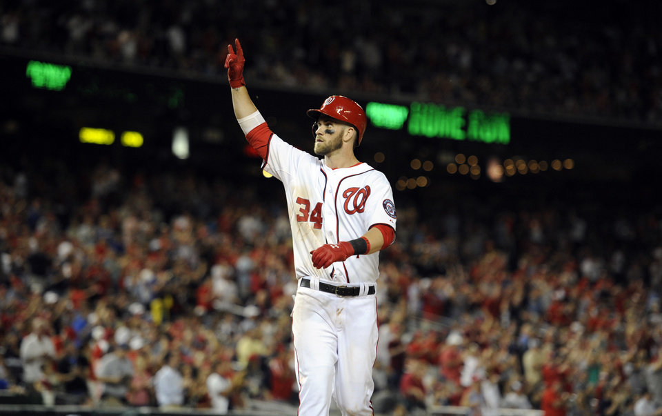 Photo - Washington Nationals' Bryce Harper gestures as he celebrates his home run against the Milwaukee Brewers during the ninth inning of a baseball game, Friday, July 18, 2014, in Washington. The Brewers won 4-2. (AP Photo/Nick Wass)
