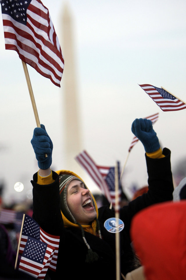 Photo - Hannah Stuart of Seattle, Wash., dances on the National Mall Tuesday, Jan. 20, 2009, before the swearing-in ceremony of President-elect Barack Obama.  (AP Photo/Matt Rourke)
