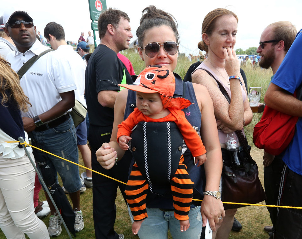Photo - A baby wearing a tiger outfit is carried on the outside of the 17th fairway on the final round of the British Open Golf championship at the Royal Liverpool golf club, Hoylake, England, Sunday July 20, 2014. (AP Photo/Jon Super)