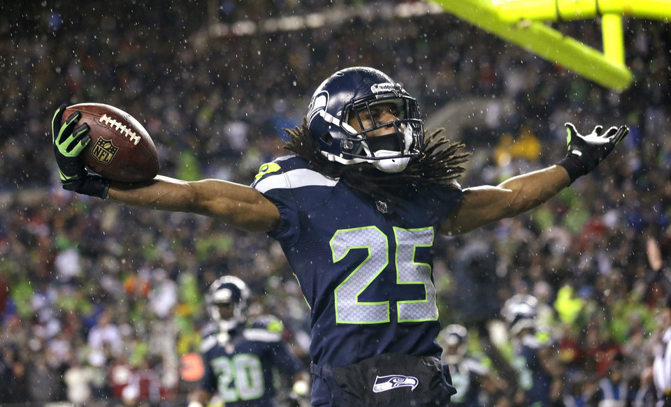 Seattle Seahawks\' Richard Sherman motions to fans after intercepting in the end zone against the San Francisco 49ers in the second half of an NFL football game, Sunday, Dec. 23, 2012, in Seattle. The Seahawks won 42-13. (AP Photo/Elaine Thompson)
