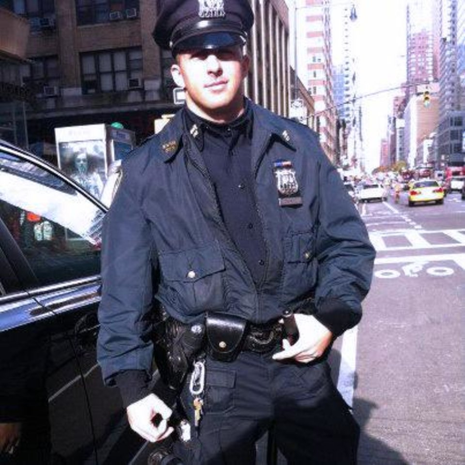 In this undated photo released by the New York City Police Department, Thursday, Nov. 29, 2012, officer Larry DePrimo is shown on-duty. DePrimo was working in Times Square on Nov. 14 when he gave a barefoot homeless man a new pair of socks and insulated boots. (AP Photo/New York Police Department)