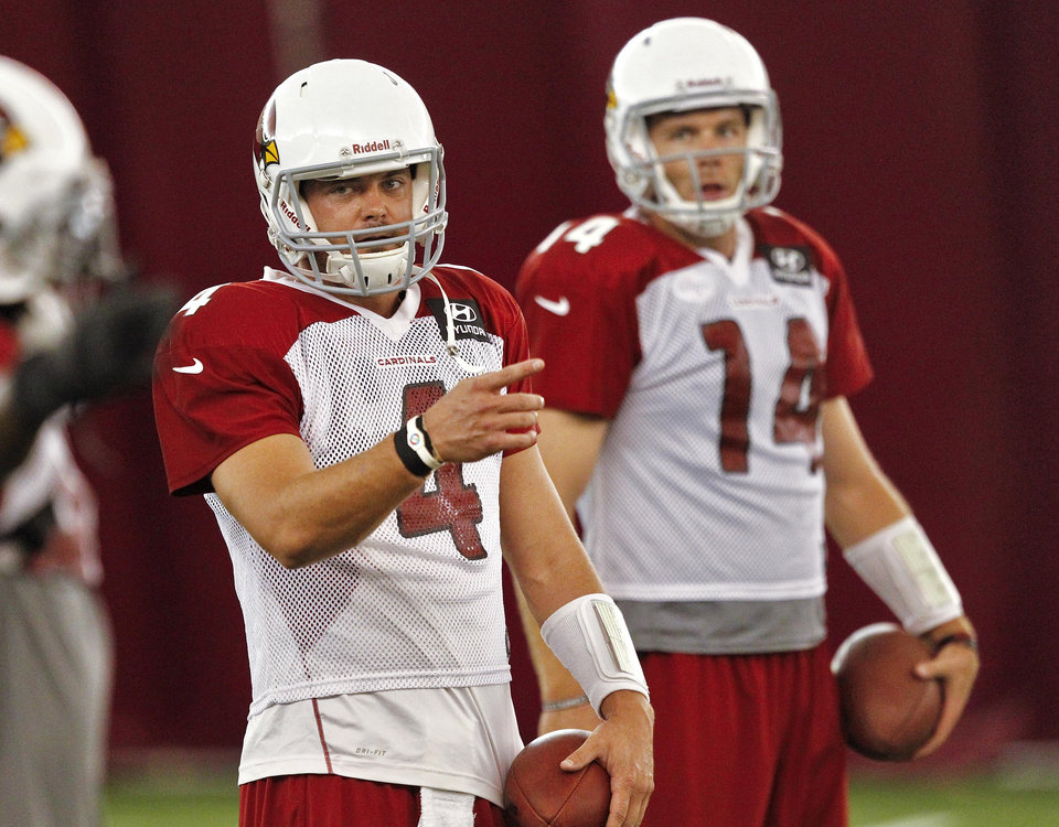 Photo -   Arizona Cardinals quarterback Kevin Kolb (4) and Ryan Lindley (14) run drills during NFL football practice on Thursday, Sept. 13, 2012, at Arizona State University in Tempe, Ariz. The Cardinals are to face the New England Patriots on Sunday. (AP Photo/Matt York)