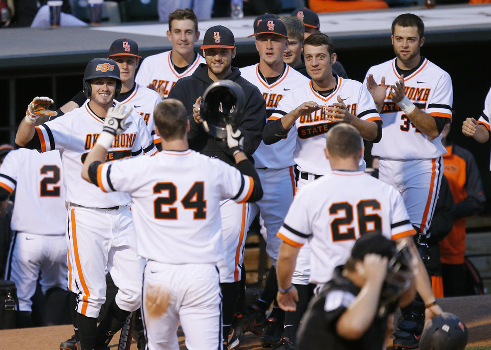 Photo - Oklahoma State celebrates a home run in the fifth inning of a Bedlam baseball game between the University of Oklahoma and Oklahoma State University at Chickasaw Bricktown Ballpark in Oklahoma City, Thursday, May 15, 2014. Photo by Bryan Terry, The Oklahoman