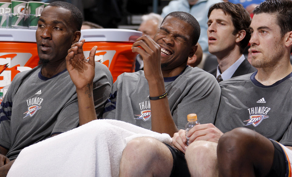 Photo - Oklahoma City's Kevin Durant laughs as he sits on the bench between Kendrick Perkins, left, and Nick Collison during an NBA game between the Oklahoma City Thunder and the Utah Jazz at Chesapeake Energy Arena in Oklahoma CIty, Tuesday, Feb. 14, 2012. Photo by Bryan Terry, The Oklahoman