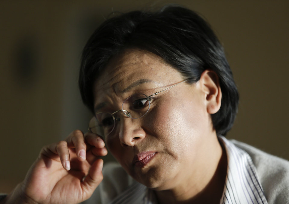 "In this Monday, March 11, 2012 photo, Hong Li talks about her husband at their house in Rancho Palos Verdes, Calif. A business rival in China had accused her husband of stealing information and providing it to Li's company. Police were asking questions. Hu called Li in California with a warning: ""Don't come back."" (AP Photo/Chris Carlson)"
