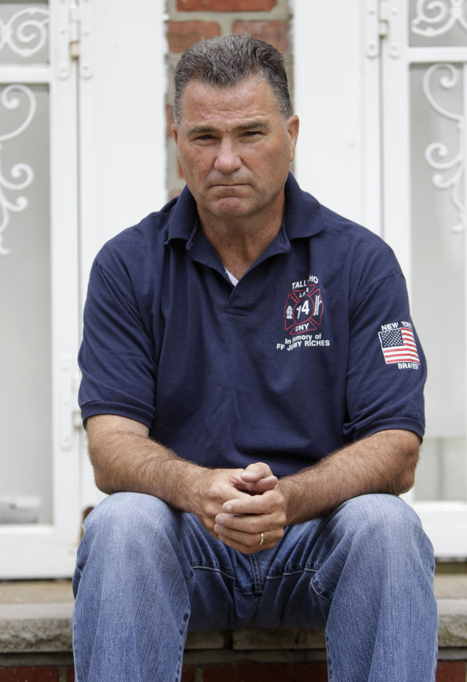 Retired firefighter Jim Riches poses for a picture near his home in New York, Thursday, May 3, 2012. Riches, whose son was killed during the 2001 terrorist attacks on the World Trade center, will be among those to watch the arraignment of Khalid Sheikh Mohammed. The arraignment of the self-proclaimed mastermind of the Sept. 11 terror attacks and four other Guantanamo Bay prisoners will be broadcast to only six sites at four military bases in the U.S. Northeast, a Pentagon spokesman said Monday. (AP Photo/Seth Wenig)