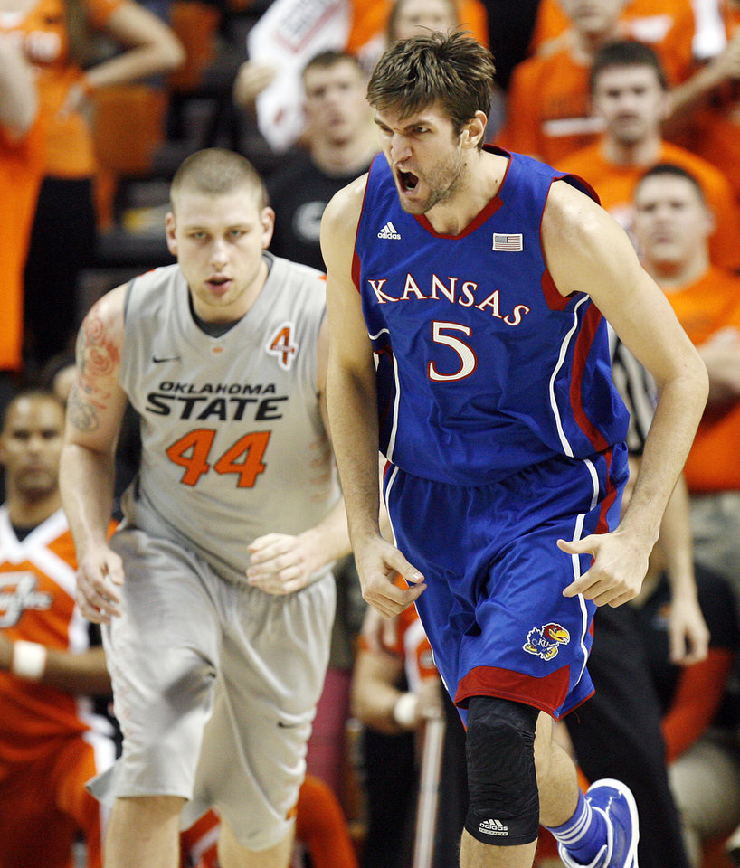 KU's Jeff Withey (5) reacts after a basket in front of OSU's Philip Jurick (44) in the first half during a men's college basketball game between the Oklahoma State University Cowboys and the University of Kansas Jayhawks at Gallagher-Iba Arena in Stillwater, Okla., Monday, Feb. 27, 2012. Photo by Nate Billings, The Oklahoman