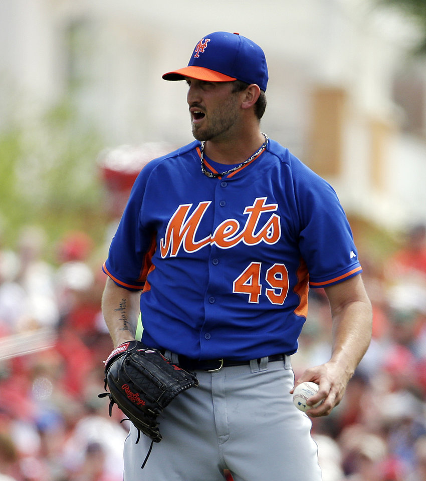 Photo - New York Mets starting pitcher Jonathon Niese looks to the outfield after walking St. Louis Cardinals' Stephen Piscotty in the second inning of an exhibition spring training baseball game, Sunday, March 16, 2014, in Jupiter, Fla. (AP Photo/David Goldman)