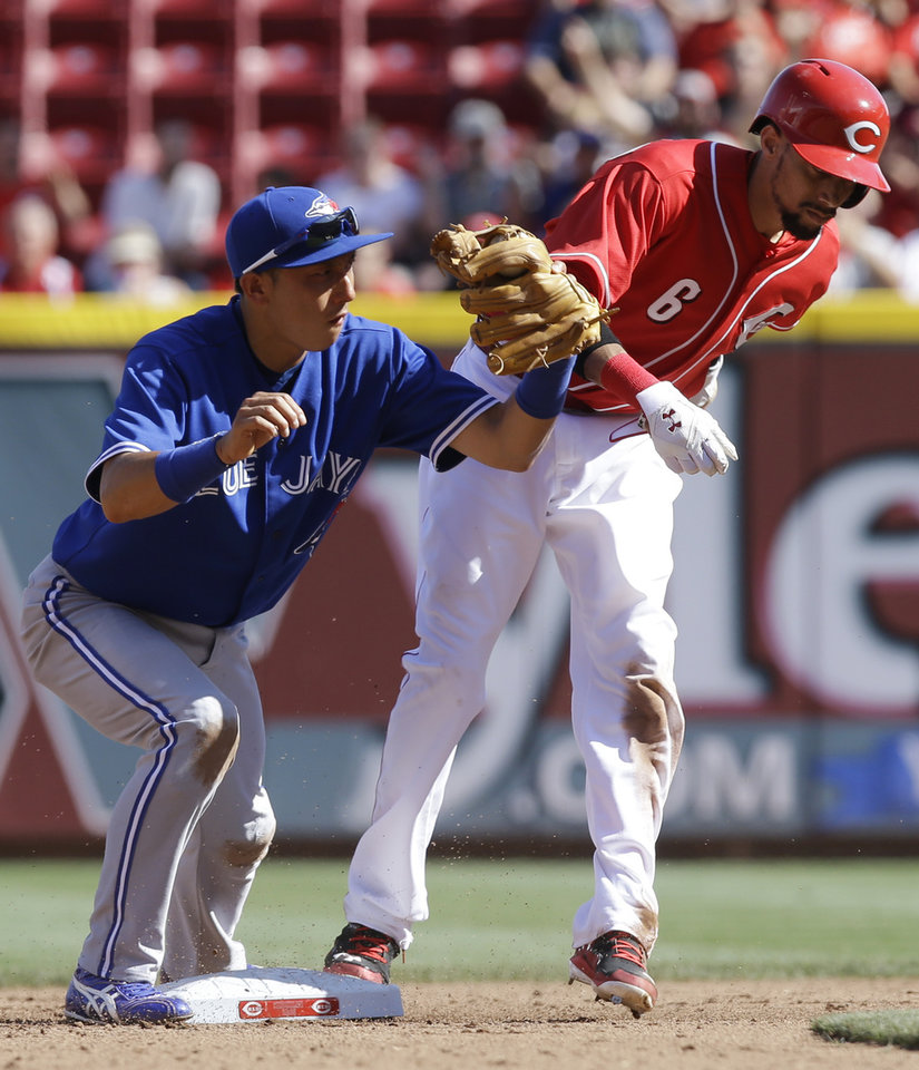 Photo - Cincinnati Reds' Billy Hamilton (6) steals second base as Toronto Blue Jays second baseman Munenori Kawasaki is late with the tag in the fourth inning of a baseball game on Saturday, June 21, 2014, in Cincinnati. (AP Photo/Al Behrman)
