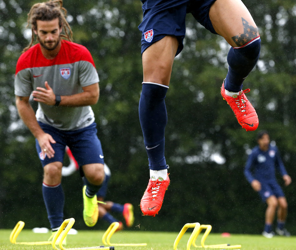 Photo - United States' Jermaine Jones, front, nd Kyle Beckerman work out during a training session at the Sao Paulo FC training center in Sao Paulo, Brazil, Tuesday, June 10, 2014. The U.S. will play in group G of the 2014 soccer World Cup. (AP Photo/Julio Cortez)