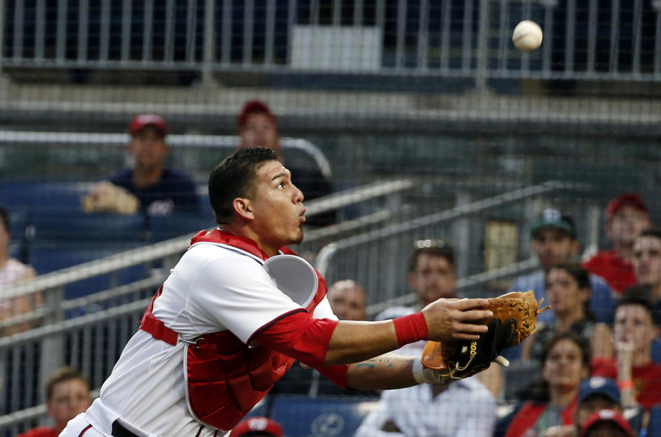 Photo - Washington Nationals' Wilson Ramos catches a foul pop up hit by Miami Marlins' Adeiny Hechavarria for an out during the third inning of a baseball game at Nationals Park Wednesday, May 28, 2014, in Washington. (AP Photo/Alex Brandon)