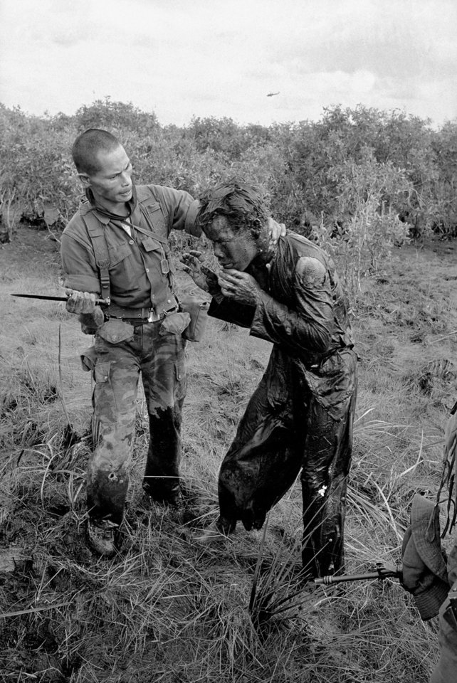 Photo -   FILE - In this Jan. 9, 1964 file photo one of several shot by Associated Press photographer Horst Faas, earning him the first of two Pulitzer Prizes, a South Vietnamese soldier uses the end of a dagger to beat a farmer for allegedly supplying government troops with inaccurate information about the movement of Viet Cong guerrillas in a village west of Saigon, Vietnam. Faas, a prize-winning combat photographer who carved out new standards for covering war with a camera and became one of the world's legendary photojournalists in nearly half a century with The Associated Press, has died May 10, 2012. He was 79. (AP Photo/Horst Faas, File)