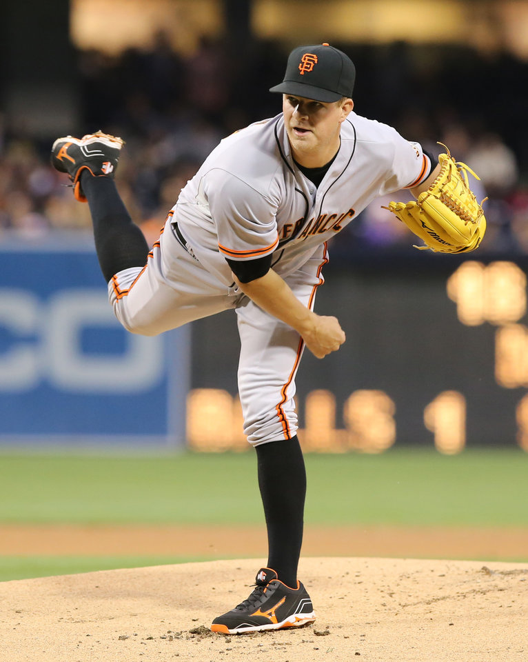 Photo - San Francisco Giants starting pitcher Matt Cain delivers in the first inning of a baseball game against the San Diego Padres, Friday, April 18, 2014, in San Diego. (AP Photo/Don Boomer)