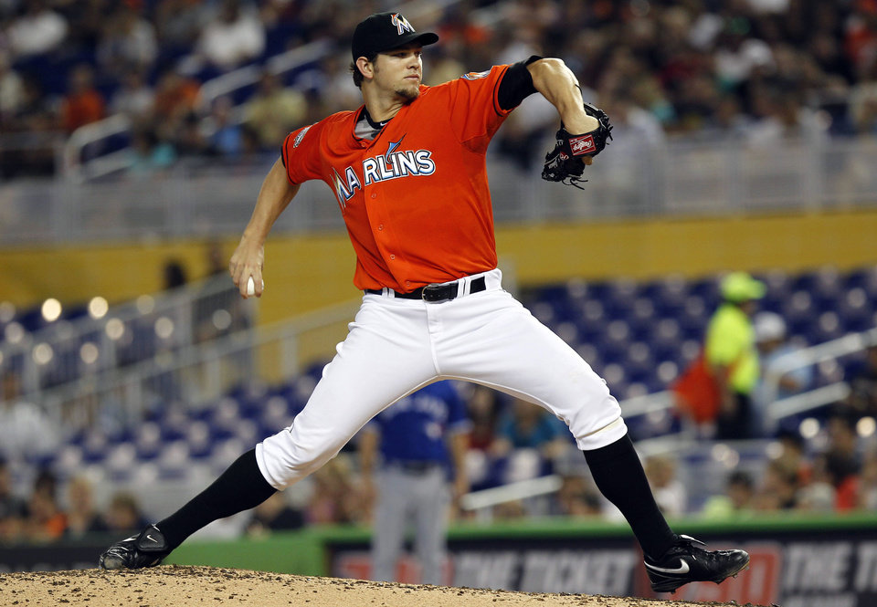 Photo -   Miami Marlins starter Josh Johnson throws to the Toronto Blue Jays during fourth the inning of a baseball game in Miami, Saturday, June 23, 2012. (AP Photo/J Pat Carter)
