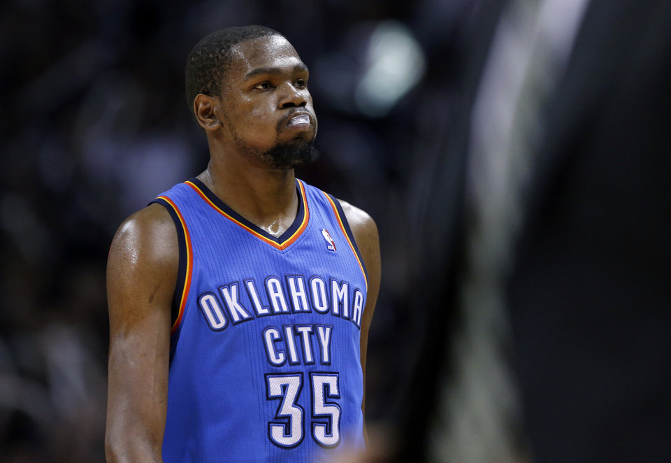 Photo - Oklahoma City's Kevin Durant (35) walks of the court for a time out during Game 5 of the Western Conference Finals in the NBA playoffs between the Oklahoma City Thunder and the San Antonio Spurs at the AT&T Center in San Antonio, Thursday, May 29, 2014. Photo by Sarah Phipps, The Oklahoman