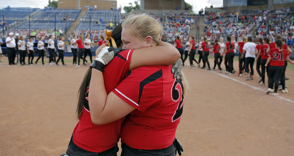 Photo - Tulsa Union's Brianna Trujillo, left, and Alexis Murray celebrate the win over Broken Arrow in the Class 6A Oklahoma State High School Slow Pitch Softball Championship at ASA Hall of Fame Stadium in Oklahoma City, Wednesday, May 1, 2013. Photo by Chris Landsberger, The Oklahoman
