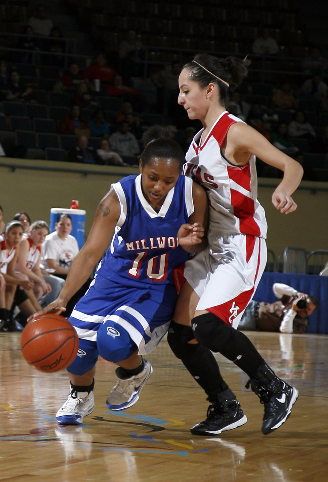 Photo - Millwood's Shea Bowden (10) tries to get around Kansas' Courtney Cowan (2) during the girls 3A semifinal between MIillwood and Kansas at the State Fair Arena, Friday, March 13, 2009, in Oklahoma City. PHOTO BY SARAH PHIPPS, THE OKLAHOMAN
