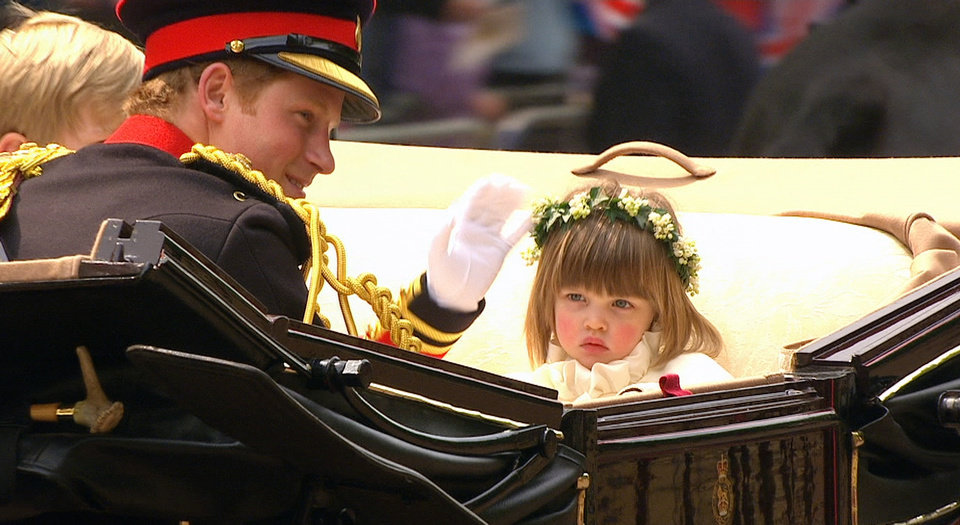 Photo - In this image taken from video, Britain's Prince Harry, waves as he sits next to bridesmaid, Eliza Lopes, in the carriage on the way to Buckingham Palace after  the Royal Wedding in London on Friday, April, 29, 2011. (AP Photo/APTN) EDITORIAL USE ONLY NO ARCHIVE PHOTO TO BE USED SOLELY TO ILLUSTRATE NEWS REPORTING OR COMMENTARY ON THE FACTS OR EVENTS DEPICTED IN THIS IMAGE ORG XMIT: RWVM310