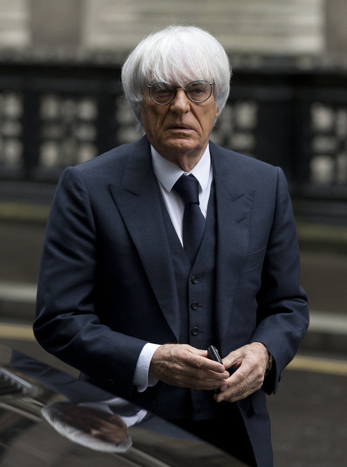 Photo - FILE - In this Nov. 11, 2013 file picture President and CEO of Formula One Management Bernie Ecclestone arrives for his case at the High Court in London. A German court says Formula One boss Bernie Ecclestone will go on trial on bribery charges. The Munich state court said Thursday Jan. 16, 2014  that it has decided to send to trial the indictment against the 83-year-old Ecclestone. He faces charges of bribery and incitement to breach of trust connected to the alleged payment of a US $45 million bribe to a German banker. Proceedings are currently expected to start at the end of April. The banker, Gerhard Gribkowsky, already has been convicted of taking the payment from Ecclestone in connection with the sale of a stake in F1. Ecclestone has insisted that he did