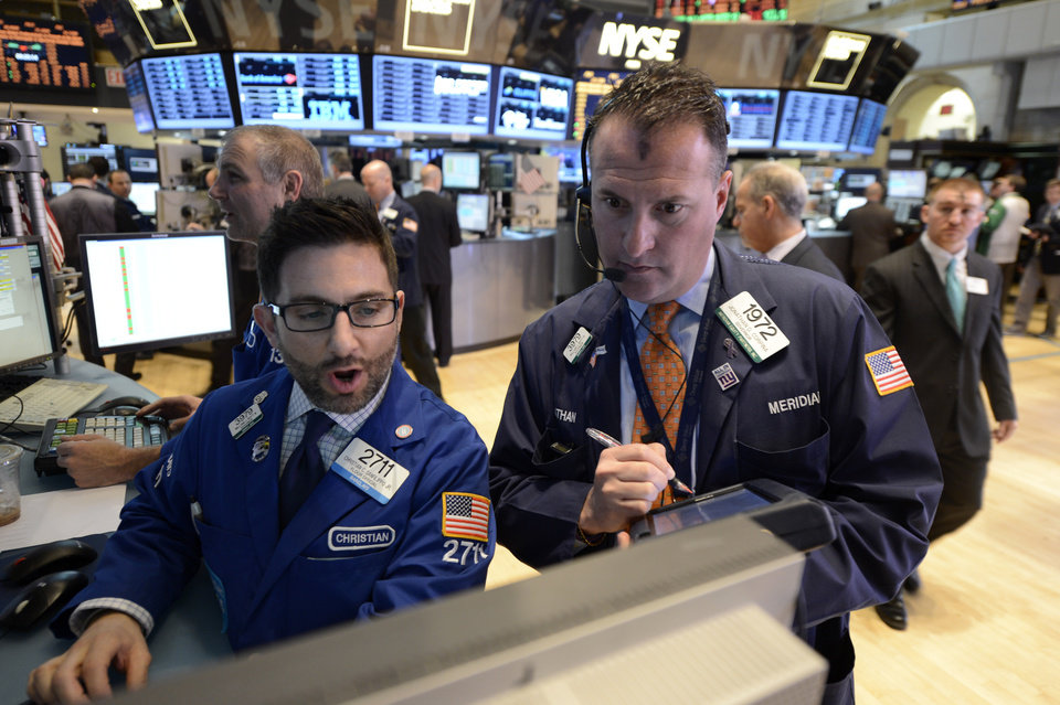 Photo - Christian Sanfilippo Jr., left, and William Bott, both of Barclays, work on the floor of the New York Stock Exchange, Wednesday, Feb. 13, 2013 in New York. (AP Photo/Henny Ray Abrams)