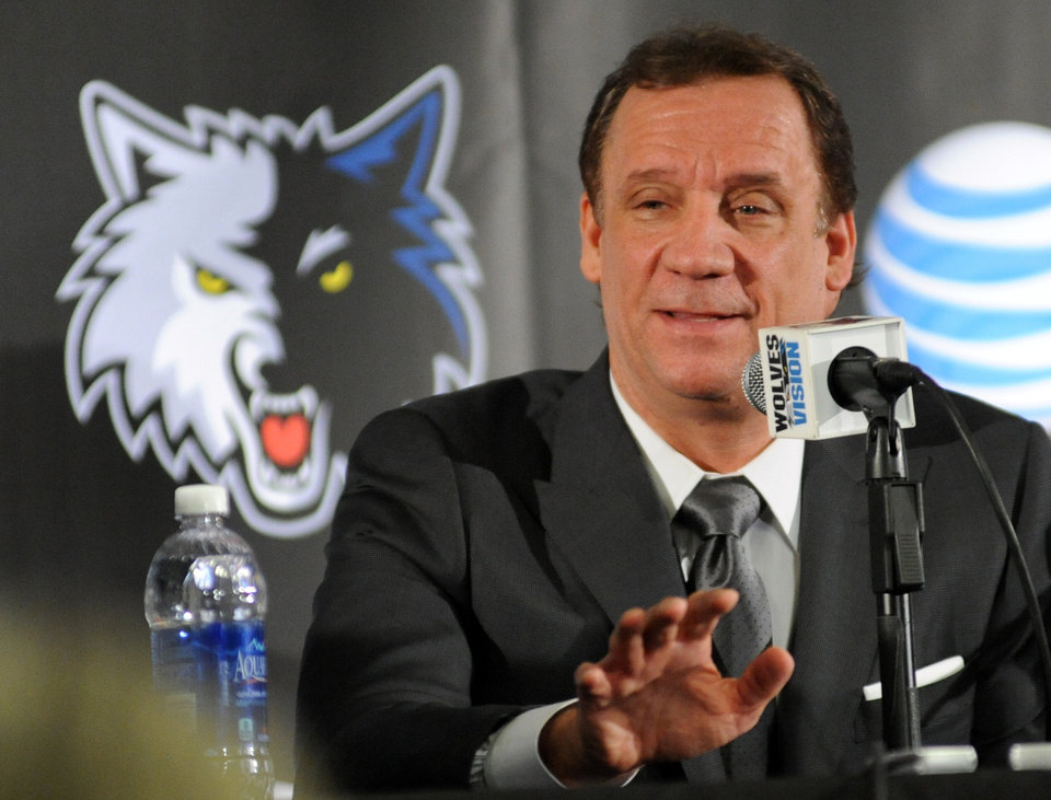In this photo taken May 3, 2013, former Minnesota Timberwolves head coach Flip Saunders is introduced as the Timberwolves' new president for basketball operations during an NBA basketball news conference in Minneapolis. It\'s seems like an odd pairing at first. Saunders, the slick, media savvy executive who wears designer suits. Rick Adelman, the curmudgeonly coach, who dresses in all black every day and has no interest in small talk. Together, they represent this long-suffering franchise\'s best chance to become relevant again. (AP Photo/The Star Tribune, Richard Sennott)