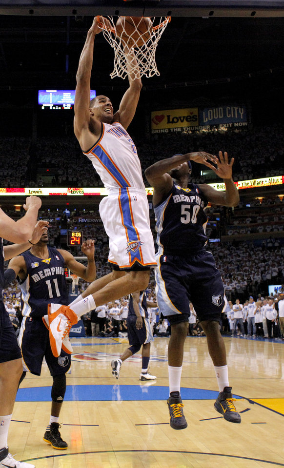 Oklahoma City\'s Thabo Sefolosha (2) dunks the ball beside Zach Randolph (50) of Memphis during game five of the Western Conference semifinals between the Memphis Grizzlies and the Oklahoma City Thunder in the NBA basketball playoffs at Oklahoma City Arena in Oklahoma City, Wednesday, May 11, 2011. Photo by Bryan Terry, The Oklahoman
