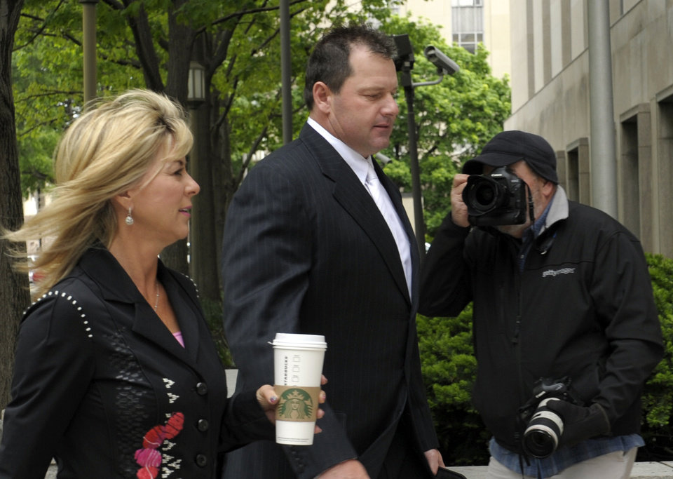 Photo -   Retired Major League baseball pitcher Roger Clemens, and his wife Debra Lynn Godfrey, arrive at federal fourt in Washington, Monday, April 23, 2012. The Clemens perjury trial moves into the next phase with the planned seating of a jury and opening arguments on Monday. (AP Photo/Susan Walsh)