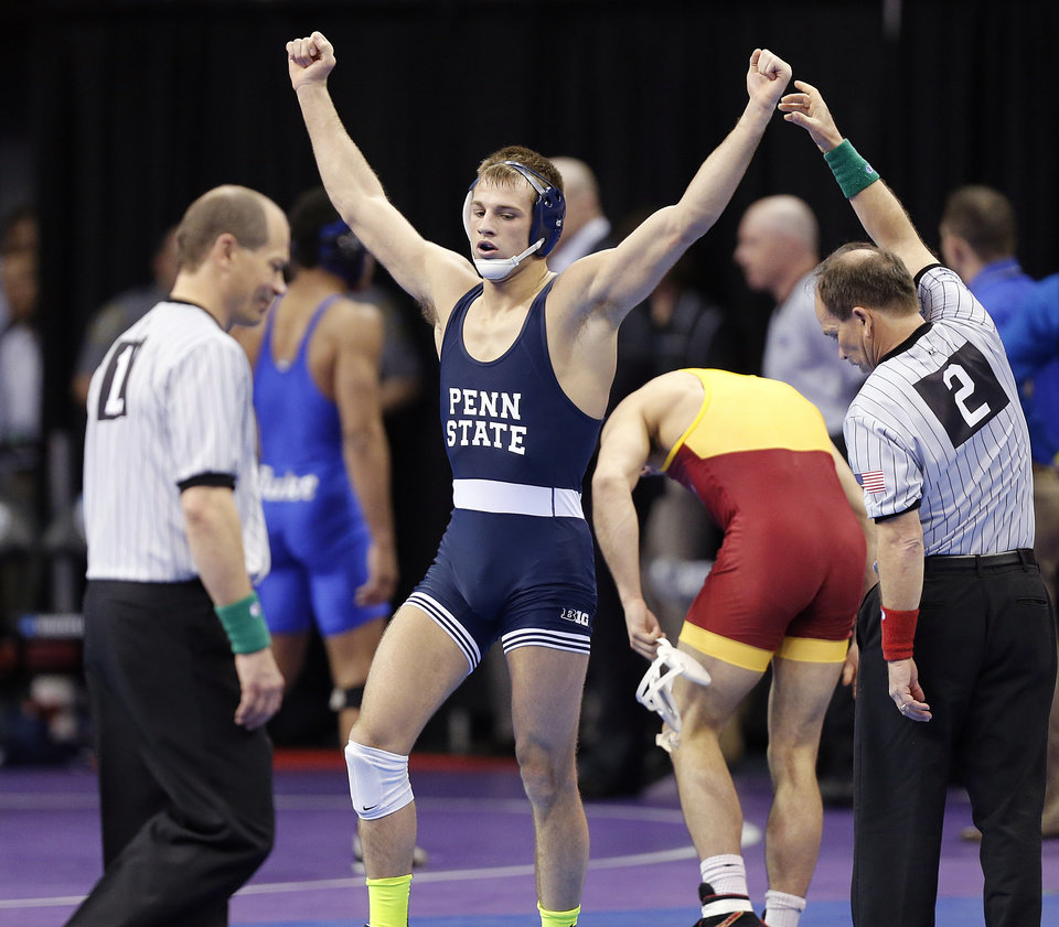 Photo - Penn State's David Taylor reacts after the win over Iowa State's Michael Moreno in the 165 pound match during the 2014 NCAA Div. 1 Wrestling Championships at Chesapeake Energy Arena in Oklahoma City, Okla. on Friday, March 21, 2014. Photo by Chris Landsberger, The Oklahoman