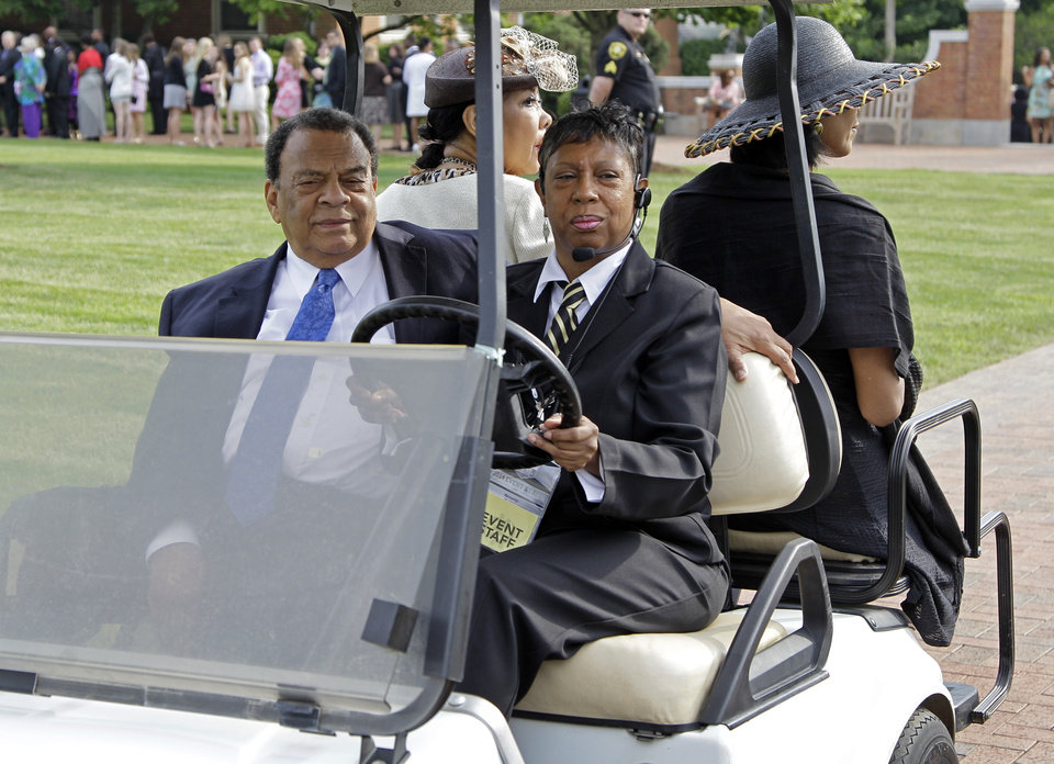 Photo - Andrew Young, front left, arrives outside Wait Chapel before a memorial service for poet and author Maya Angelou at Wait Chapel. at Wake Forest University in Winston-Salem, N.C., Saturday, June 7, 2014. Former President Bill Clinton and Oprah Winfrey are joining First Lady Michelle Obama at the service. (AP Photo/Chuck Burton)