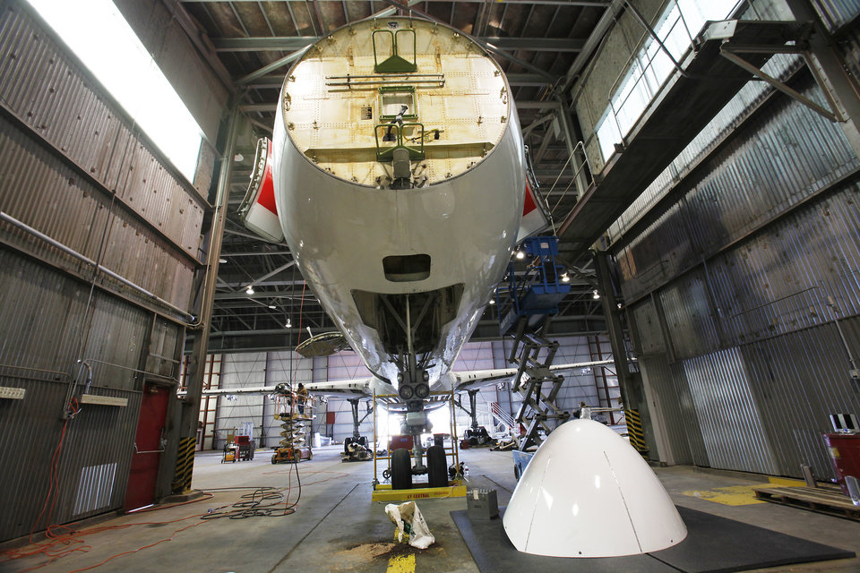 Photo - Aircraft undergoes maintenance at First Wave in one or the hangers at the Oklahoma Space Industry Development Authority's Spaceport in Burns Flat, January 11, 2010.   By David McDaniel, The Oklahoman. ORG XMIT: KOD