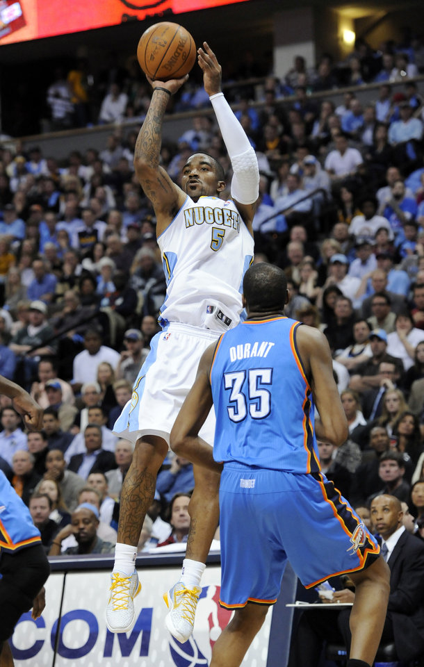 Photo - Denver Nuggets guard J.R. Smith (5) shoots a three point shot against Oklahoma City Thunder forward Kevin Durant (35) during the second half in game 4 of a first-round NBA basketball playoff series Monday, April 25, 2011, in Denver. Denver beat Oklahoma 104-101. Oklahoma City leads the series 3-1. (AP Photo/Jack Dempsey)