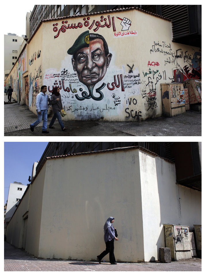 Photo -   FILE - In this file combo image of two photos taken in the same location; on March 22, 2012, above, an Egyptian couple walks by a mural depicting military ruler Field Marshal Hussein Tantawi on the left side of the face and ousted president Mubarak, right side with Arabic that reads,