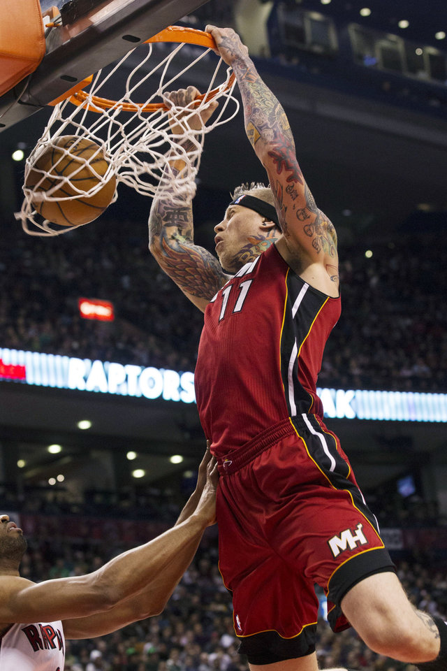 Photo - Miami Heat's Chris Anderson dunks against the Toronto Raptors during the first half of an NBA basketball game, Sunday, March 17, 2013, in Toronto. (AP Photo/The Canadian Press, Chris Young)